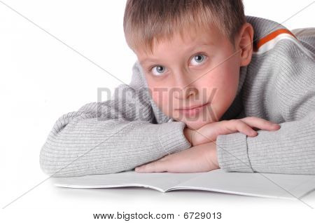 Young Boy Laying On The Floor Isolated Over A White Background
