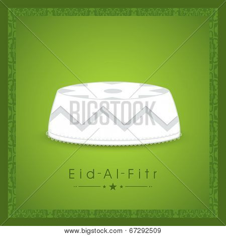 Islamic religious cap on floral decorated green background for Muslim community festival Eid-Al-Fitr.