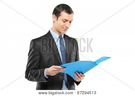 Businessman reading a document isolated on white background