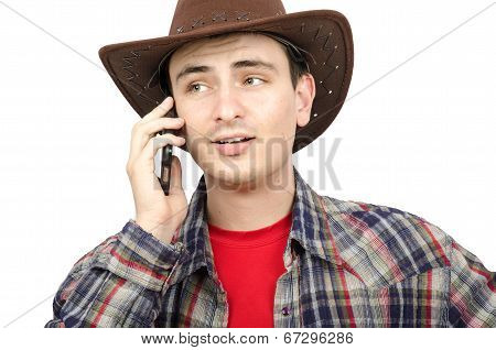 Portrait Of Young Cowboy With Ironic Smile