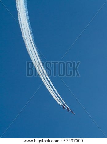 The Red Arrows British RAF aerobatic display team with blue sky