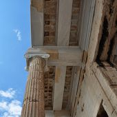 stock photo of ionic  - Ionic column and marble ceiling ancient architecture detail - JPG