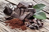 foto of cocoa beans  - Chocolate and cocoa bean over wooden table - JPG