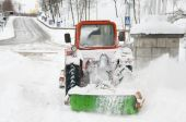 stock photo of parking lot  - Snowplow during blizzard lots of snowy noise - JPG