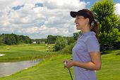 picture of ladies golf  - Woman golfer on the golf course - looking at copy space ** Note: Soft Focus at 100%, best at smaller sizes - JPG