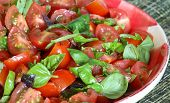 pic of plum tomato  - Summer salad with plum baby tomato greek purple lime and genovese basil in country style red gingham plate