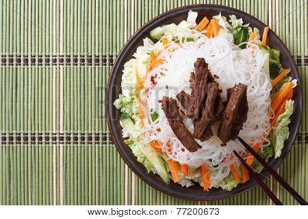 Delicious Asian Salad Rice Noodles And Meat Top View