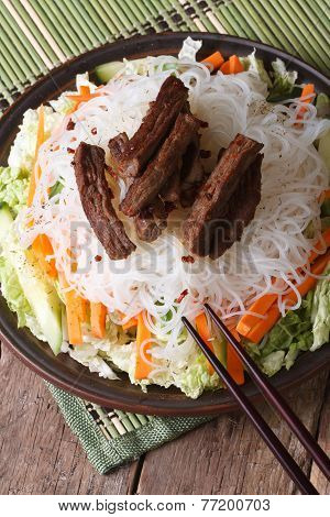 Asian Rice Noodles With Meat And Vegetables Vertical