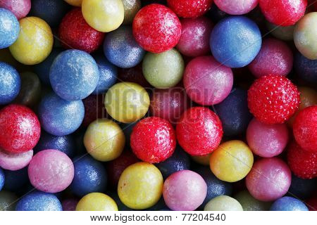 Colorful sweet sugar pearls. Candy, cakes, cookies eatable decoration. Extreme close-up background, pattern.