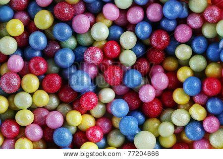 Colorful sweet sugar pearls. Candy, cakes, cookies eatable decoration. Background, pattern.