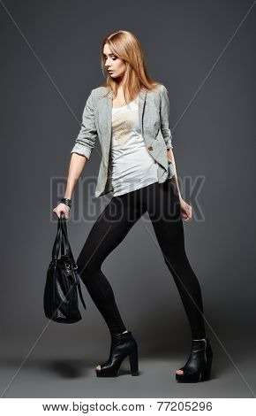 Beautiful Young Woman In Leggings, Jacket And Shirt, With Bag In Hand