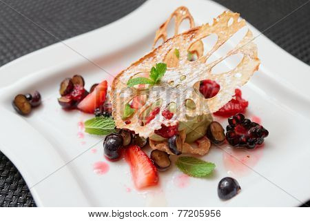 Asian fruit dessert with lotus root and berries