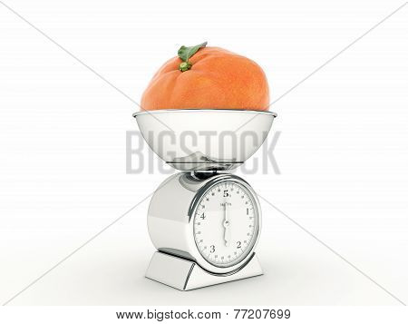 kitchen scale with giant tangerine