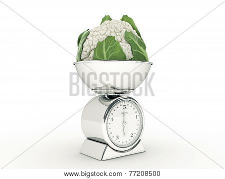 kitchen scale with giant cauliflower