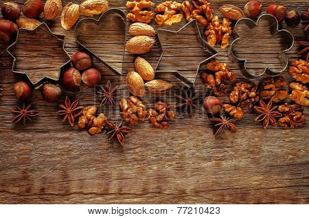 Christmas Background With Cookie Cutters, Nuts And Anisetree