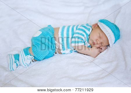 Baby sleeping. Newborn, kid art. Beauty child sleep in shoes and nice clothing