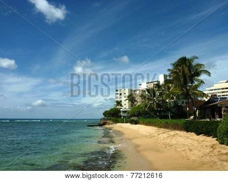 Makalei Beach With Waves Lapping, Napakaa, Lava Rock Wall And Small Hotels Along The Shore
