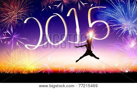 Happy New Year 2015 . Young Man Jumping And Drawing