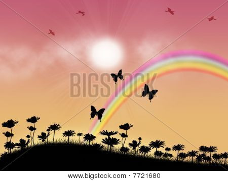 Rainbow on floral meadow