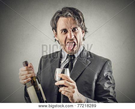 Businessman drinking wine and making jokes