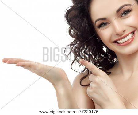 closeup portrait of attractive  caucasian smiling woman brunette isolated on white studio shot lips toothy smile face hair head and shoulders looking at camera tooth pointing to