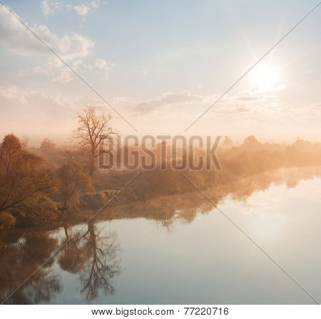 sunset in fog on the river