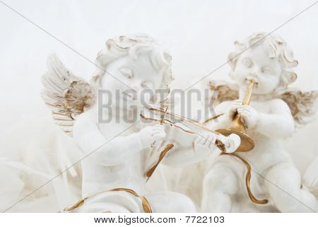 Figurines In The Form Of The Angel Playing Musical Instruments