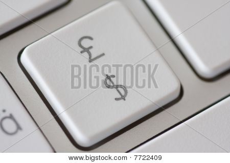 British Pound And American Dollar Symbol On Keyboard