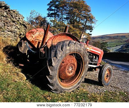 Rusty red tractor.