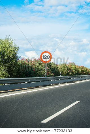 Empty Asphalt Road With Speed Limit Sign.