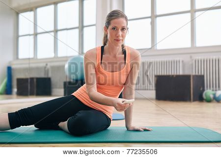 Fitness Woman At Gym With A Smartphone