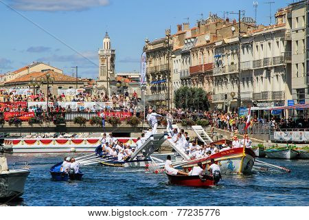 Water Jousting Performance During St.louis Festival At The Streets Of Sete, South Of France