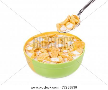 Bowl of corn flakes and milk.