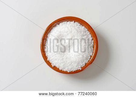 overhead view of coarse grained salt in the ceramic bowl