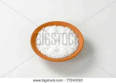 round ceramic bowl with granular salt