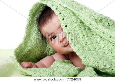 Cute Happy Baby Between Green Blankets