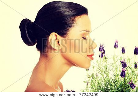 Beautiful girl smell purple lavender flowers