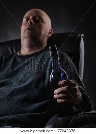 Sleeping Middle Aged Alcoholic And Wine Bottle