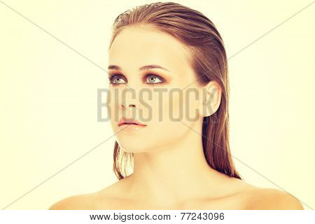 Attractive woman's portrait. Closeup. She's looking up. Isolated on white.