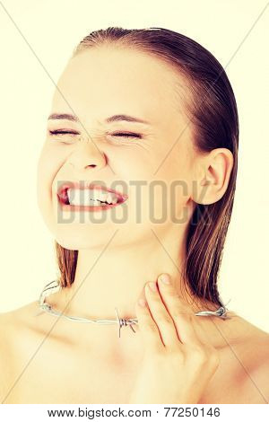Throat pain concept. Young woman with barbed wire around her throat. Isolated on white