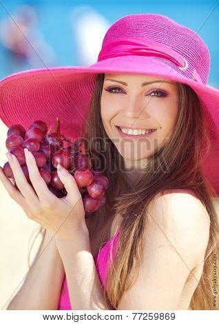 Girl with a bunch of grapes