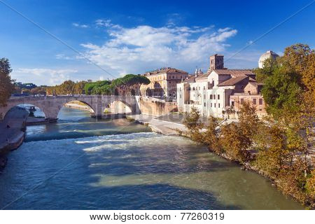 Tiber Island and Pons Cestius bridge in Rome, Italy