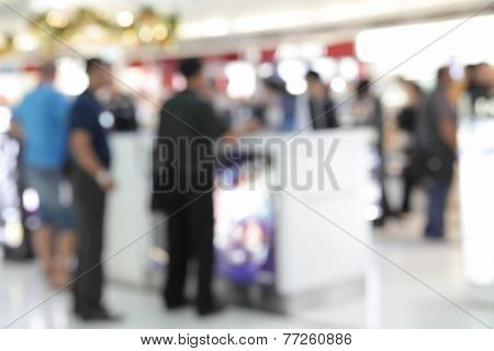 Background of duty free shop in airport with people out of focus