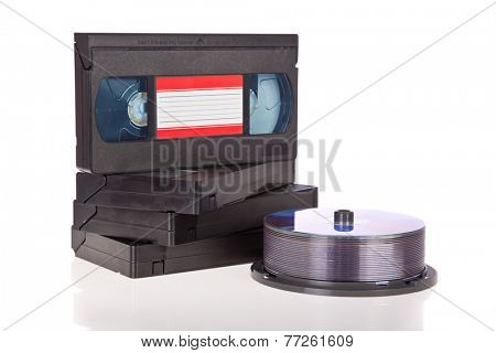 Old Video Cassette tapes with DVD discs isolated on white background