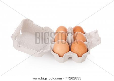 Half dozen brown chicken eggs in box isolated on white background