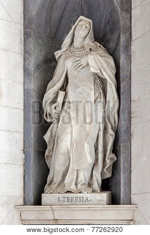 Saint Teresa of Avila. Italian Baroque sculpture - 18th century - in Mafra National Palace and Convent in Portugal. Baroque architecture