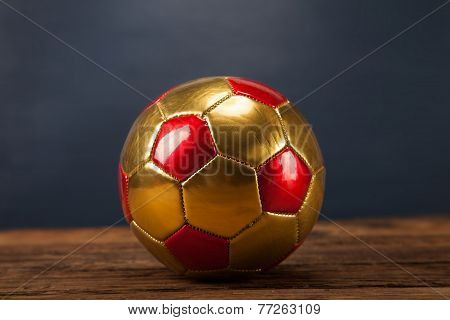 Ball On Wooden Table And Blue Background