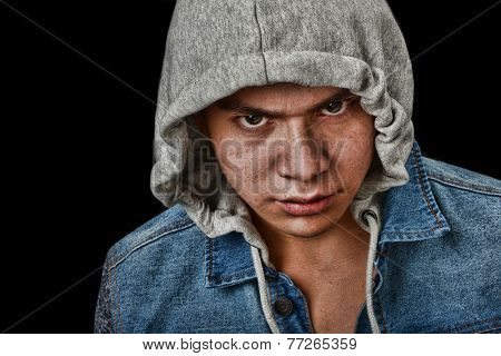 Very striking Image of a very angry latino Youth