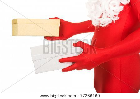 Close up on santa hands holding gifts.
