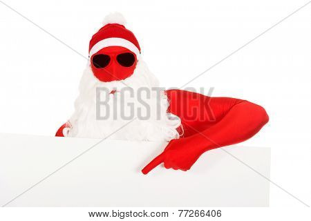 Portrait of santa in latex clothes showing empty banner.
